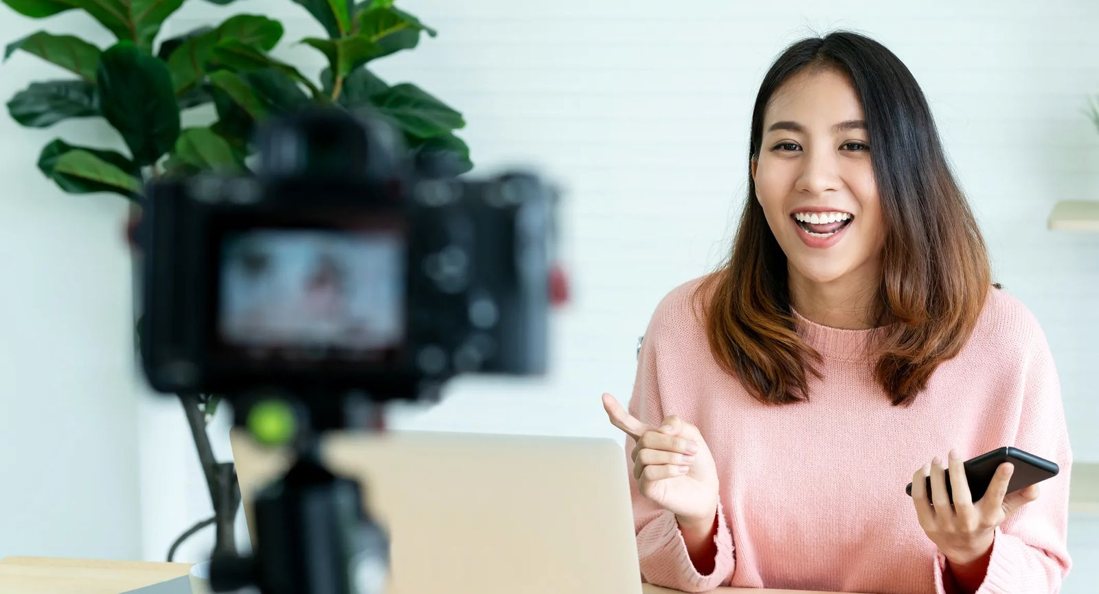 How to Make Money as a Content Creator. Woman in front of video camera.